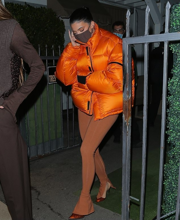 Kylie Jenner rocking narrow cognac Givenchy sandals with pointy heel and thin ankle strap