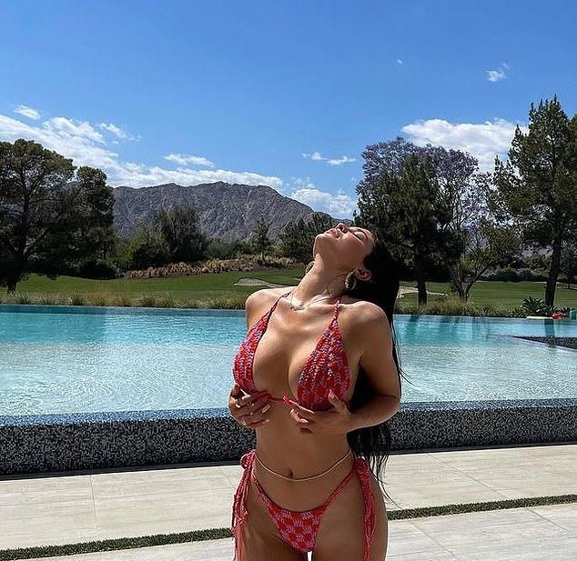 Kylie Jenner wearing skimpy pink checks bikini bottom with tied waist
