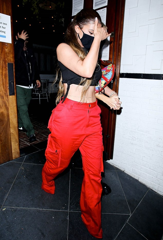 Kylie Jenner donning baggy red low rise cargo pants