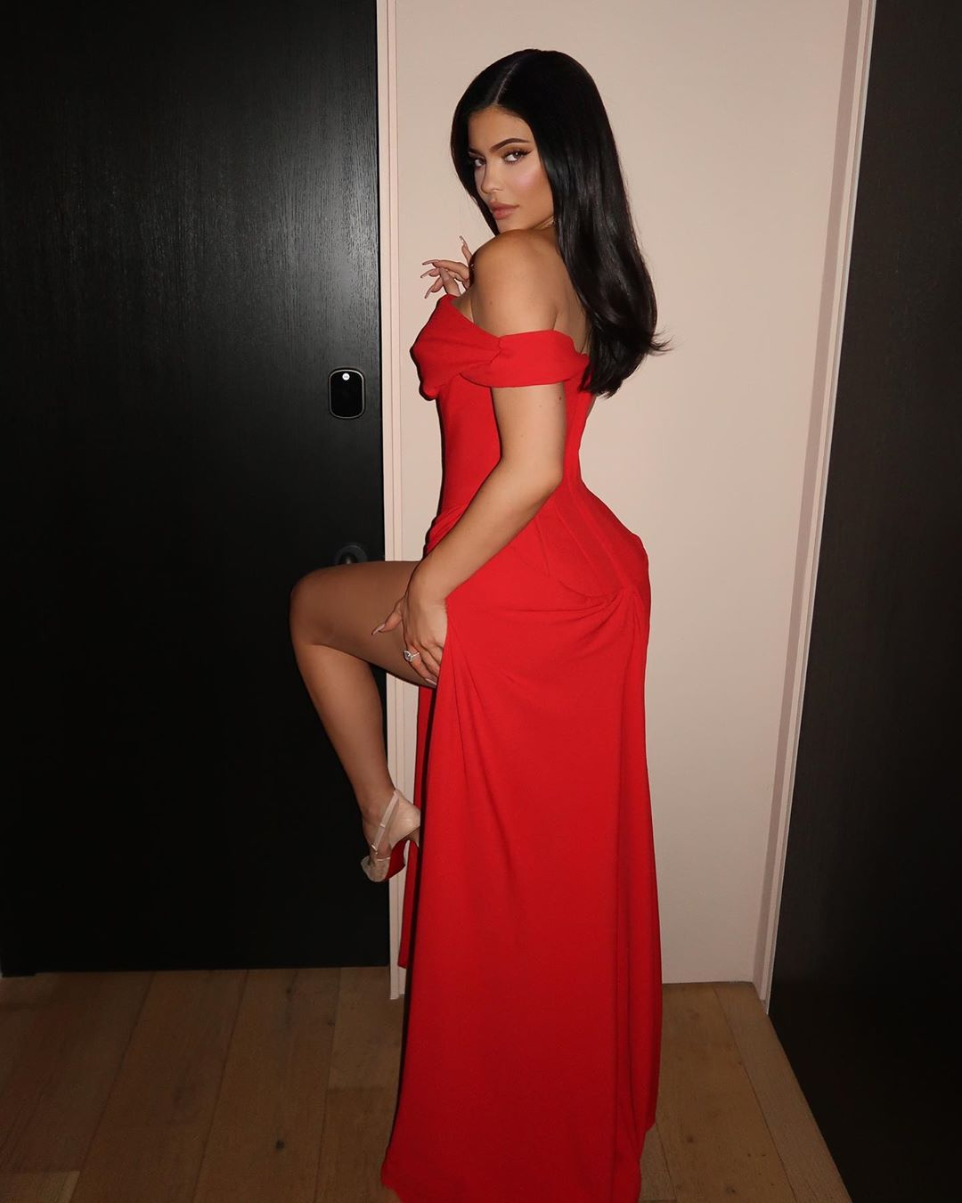 Kylie Jenner donning a Sexy red dress with a satin material, cap sleeves and gathered waist