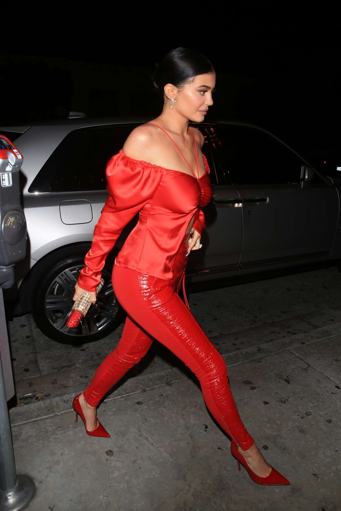 Kylie Jenner wearing High rise bright red leather jeggings with a leather fabric