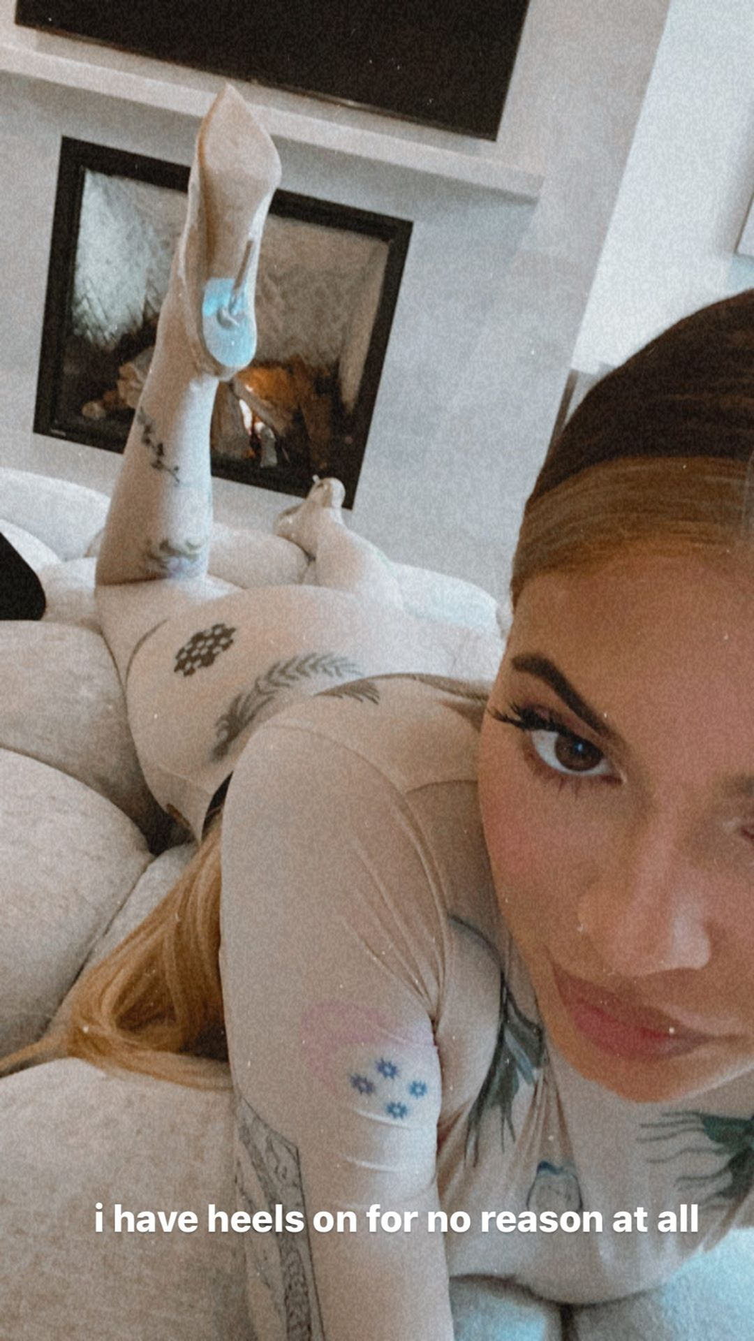 Kylie Jenner rocking completely see-through white Yeezy pumps with high heel