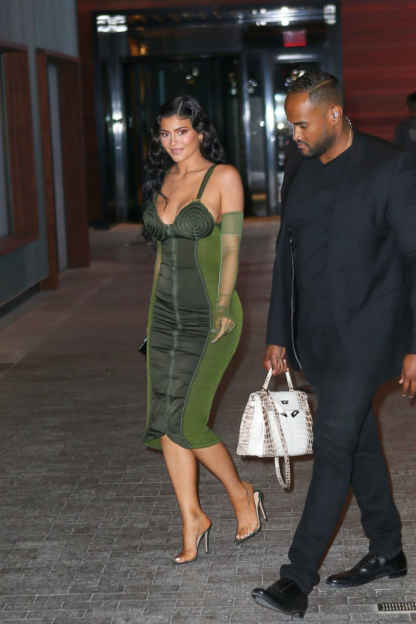 Kylie Jenner wearing pointed completely see-through sandals with high heel