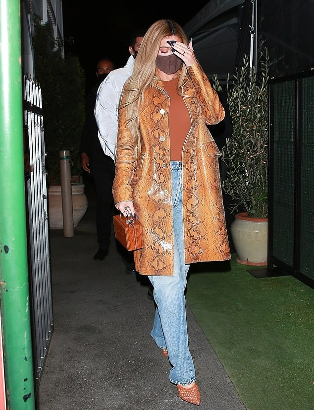 Kylie Jenner rocking pointy tan brown mules with high heel