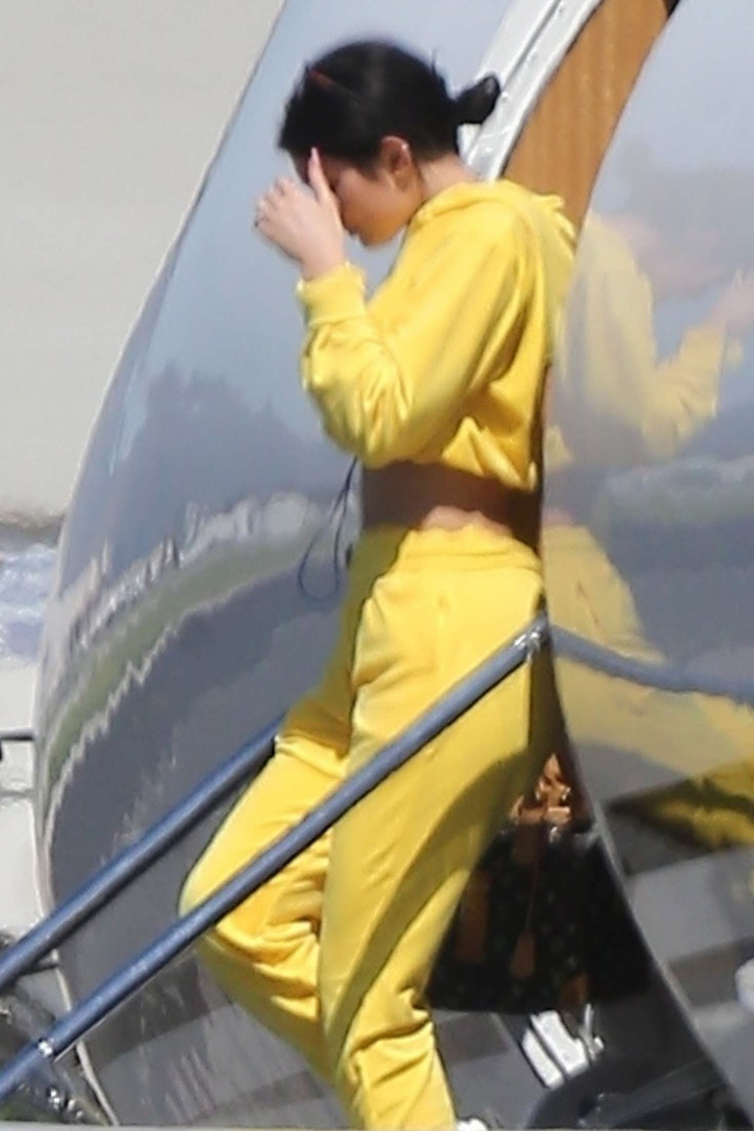 Kylie Jenner, velvet, Danielle Guizio  hoodie, yellow  hoodie, black purse, stomach length, full sleeves, high rise, hooded, oversized, cropped