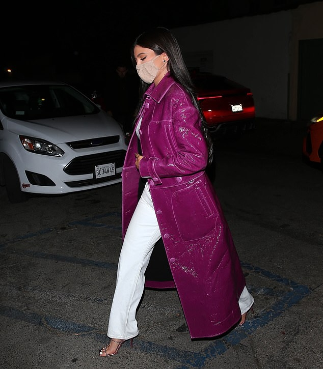 Kylie Jenner rocking crystal embellished rose gold leather slip on sandals by Amina Muaddi with high heel