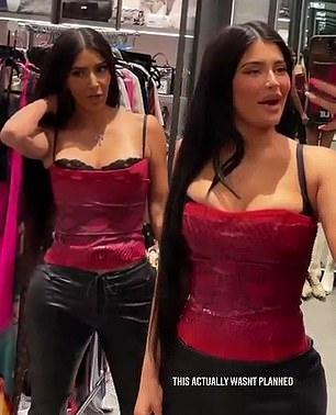 Kylie Jenner wearing a shiny black figure hugging leather mini skirt