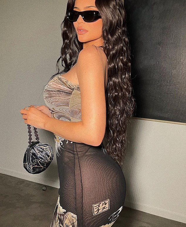 Kylie Jenner wearing a printed strapless dress with a semi-sheer material