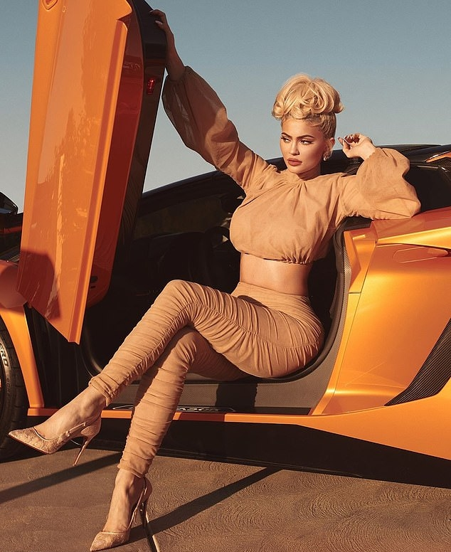 Kylie Jenner donning completely see-through Nude pumps with ice pick heel