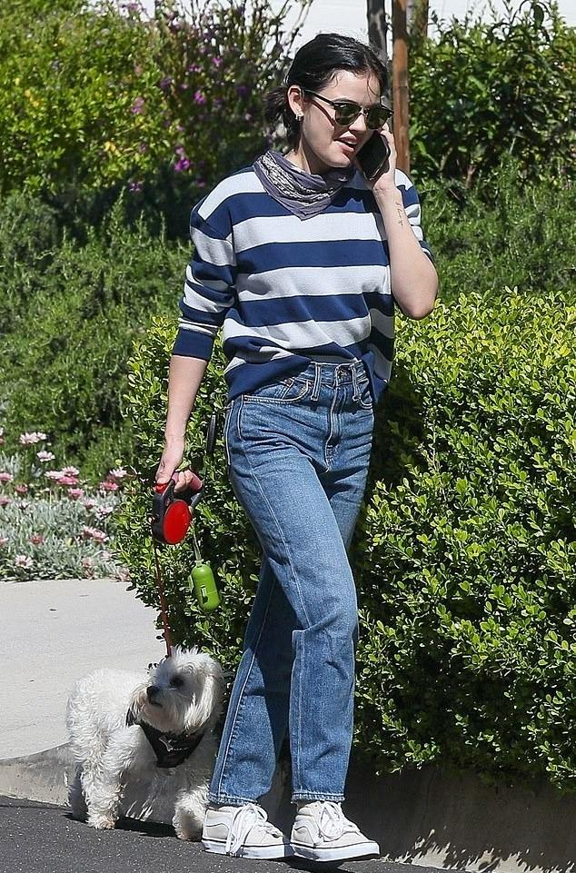 Lucy Hale donning Straight fit blue denim high rise jeans with a denim fabric