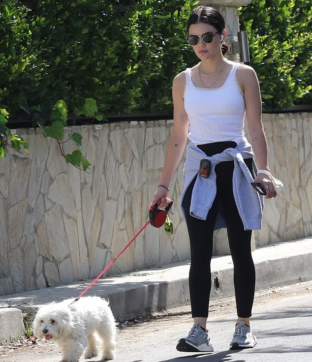 Lucy Hale donning brand logo grey Nike lace-up sneakers