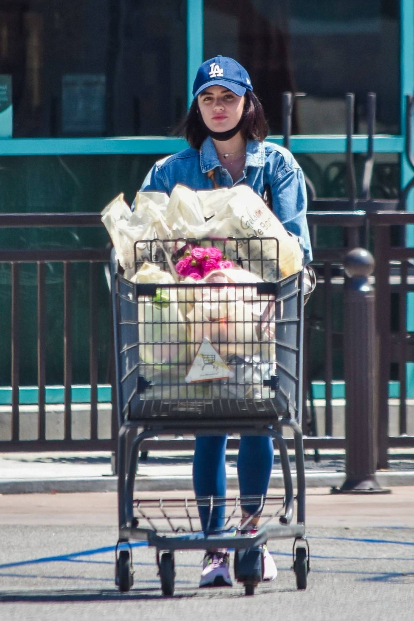 Lucy Hale donning pink mesh lace-up sneakers with chunky sole