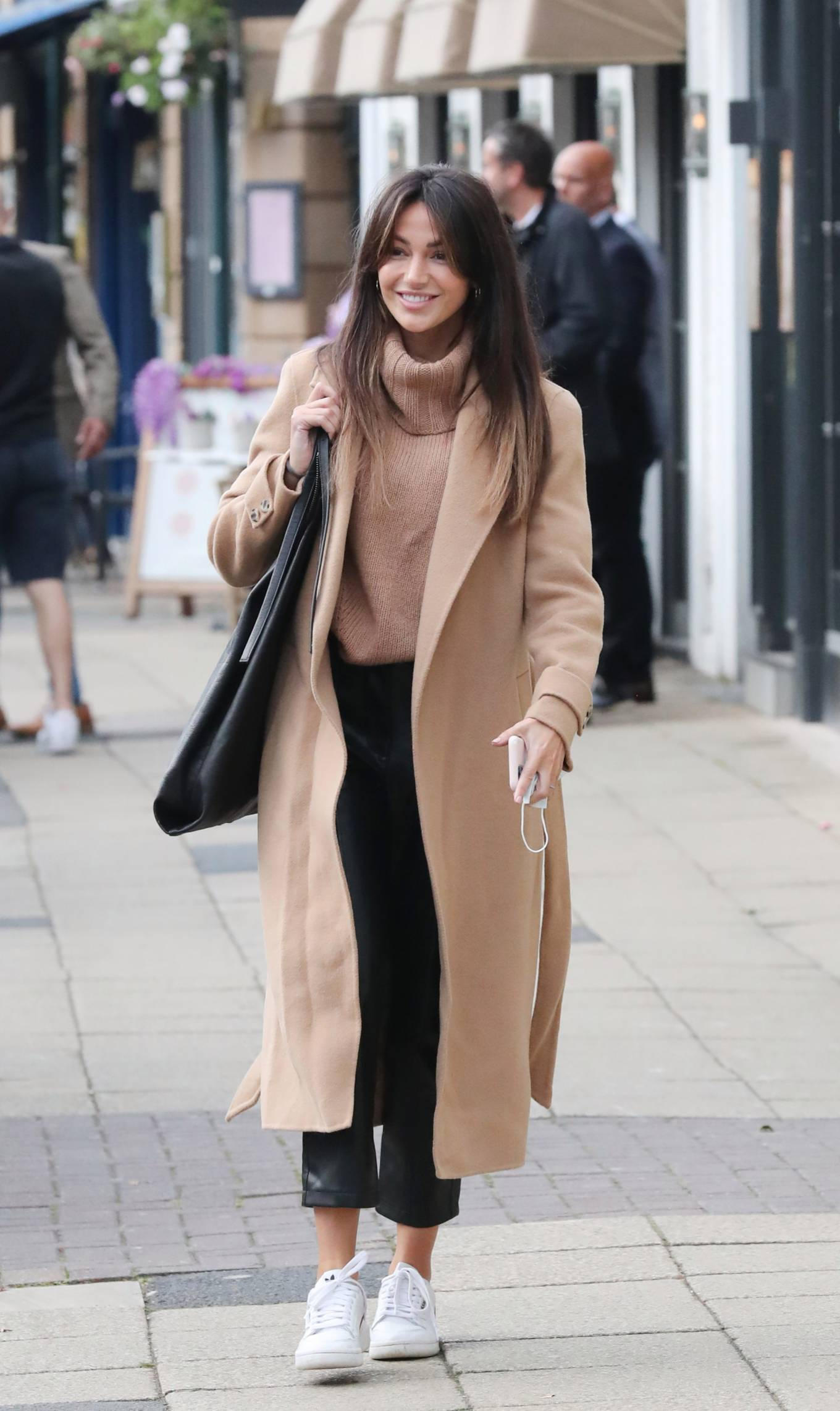 Michelle Keegan donning white Nike lace-up sneakers