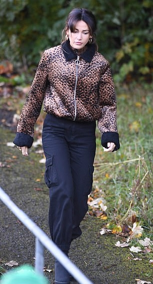 Michelle Keegan rocking a metallic bronze tucked in luxe velvet jacket with full sleeves, shirt collar and quilted