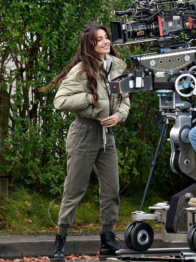 Michelle Keegan rocking a oversized Sage green puffer jacket with puffy sleeves, stand-up collar and side pockets