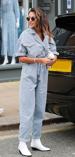 Michelle Keegan donning narrow white leather ankle boots with square heel