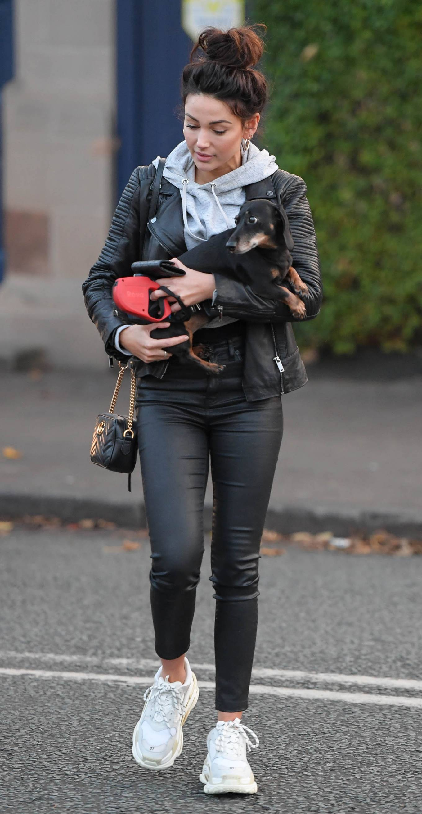 Michelle Keegan donning a grey tucked in hoodie with full sleeves