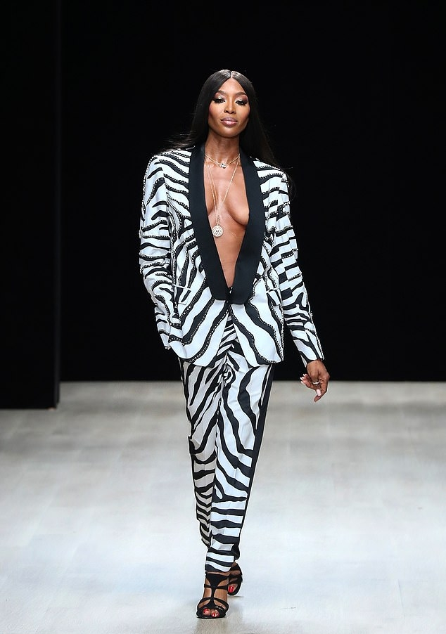 Naomi Campbell wearing a Menswear inspired white and black zebra print tuxedo with extra long sleeves, tuxedo collar and beaded