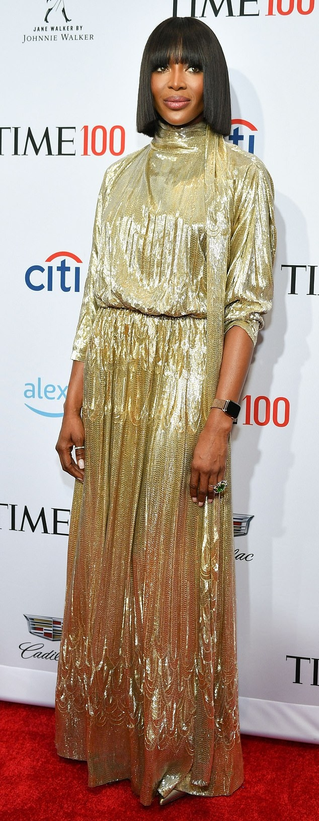 Naomi Campbell wearing a Flattering shiny gold Valentino dress with a sequin detailing material, 3/4 sleeves, gathered shoulder, embroidered and a turtleneck
