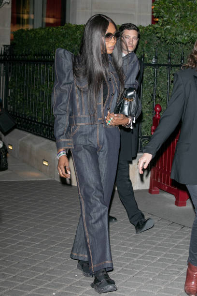 Naomi Campbell rocking a black tucked in bodysuit with a turtleneck