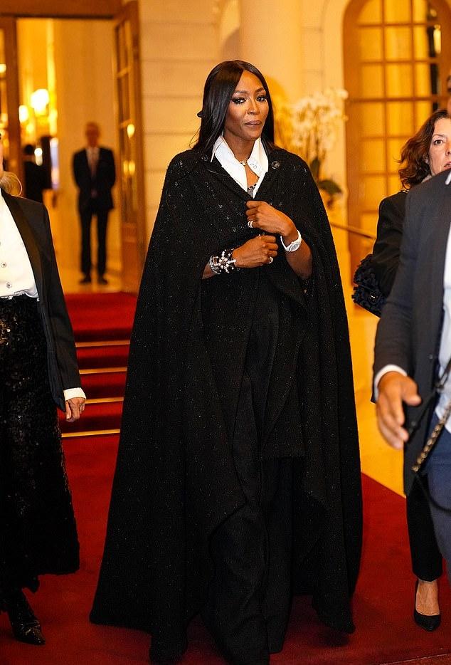 Naomi Campbell rocking a Flowing maxi dress with 3/4 sleeves and shirt collar