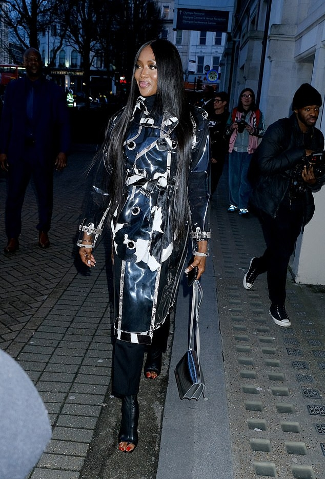 Naomi Campbell donning black leather open toe mules with high heel