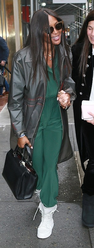 Naomi Campbell rocking white leather ankle high top sneakers