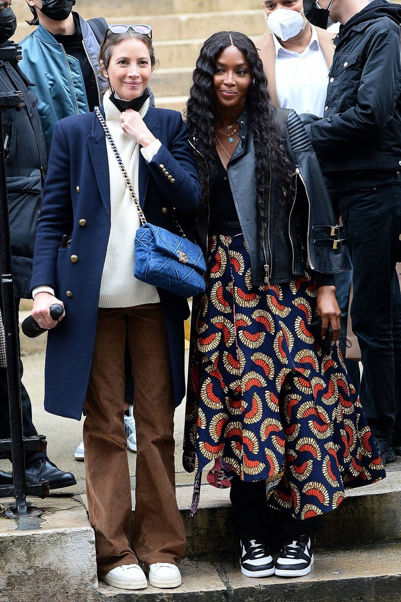 Naomi Campbell donning a black quilted leather biker jacket with bell sleeves, shirt collar and zipper accents