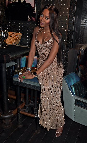 Naomi Campbell sparkled in bronze open toe sandals with high heel and wide strap