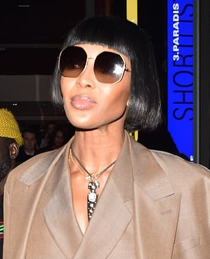 Naomi Campbell donning pointy black pumps with high heel