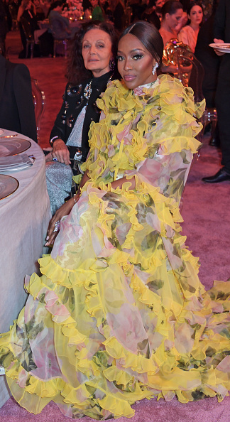 Naomi Campbell dazzled in a ruffled Valentino yellow dress with a georgette fabric, ruffle sleeves, asymmetric design, a ruffle neck and ruffled hem