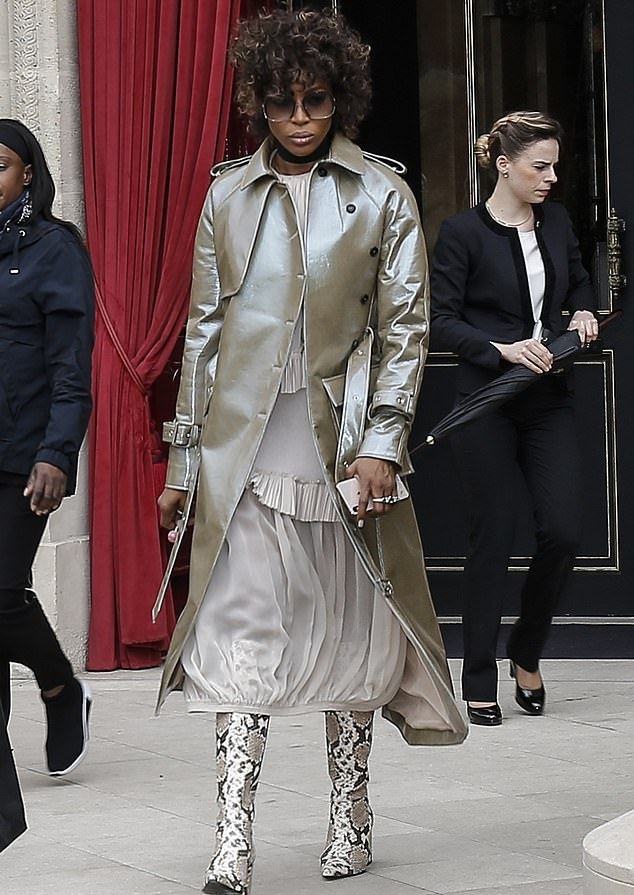 Naomi Campbell donning narrow white grey mid calf boots with block heel