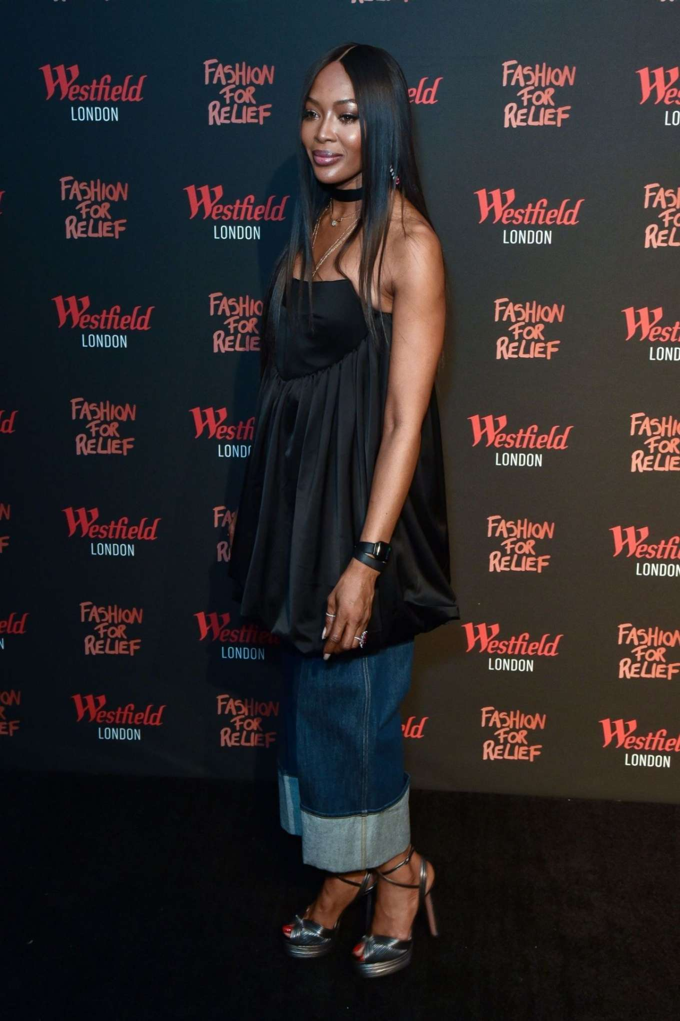 Naomi Campbell rocking a Voluminous black pleated Tunic with a satin material, pleated, gathered waist and flared hem