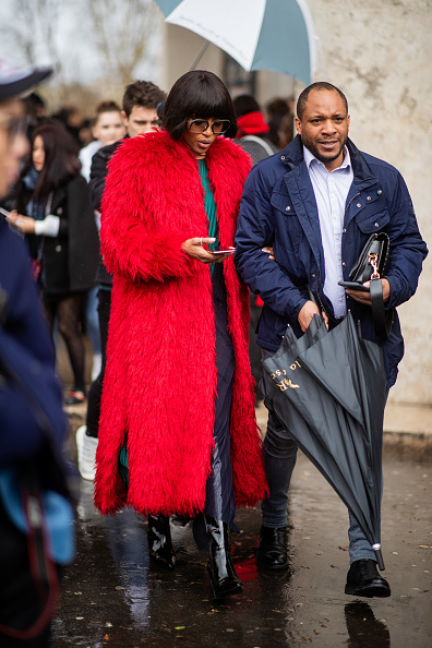 Naomi Campbell wowed in a voluminous red feather coat with full sleeves and feather bolero