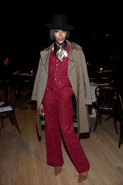 Naomi Campbell donning straight fit red pinstriped trousers with side pockets