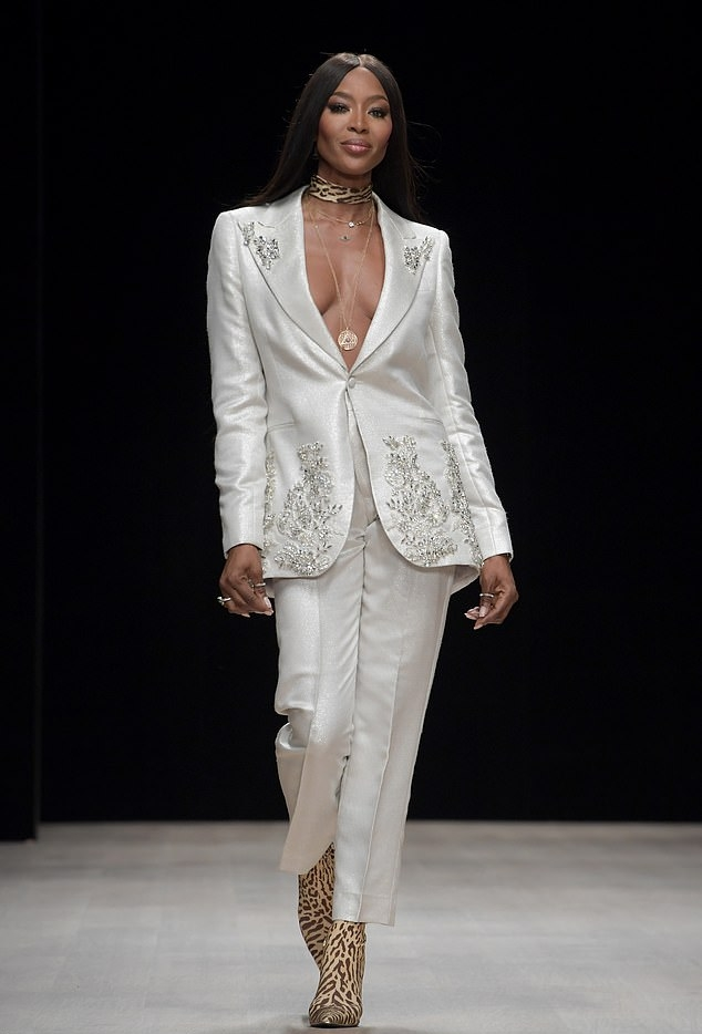 Naomi Campbell donning Matching shiny white cropped trousers