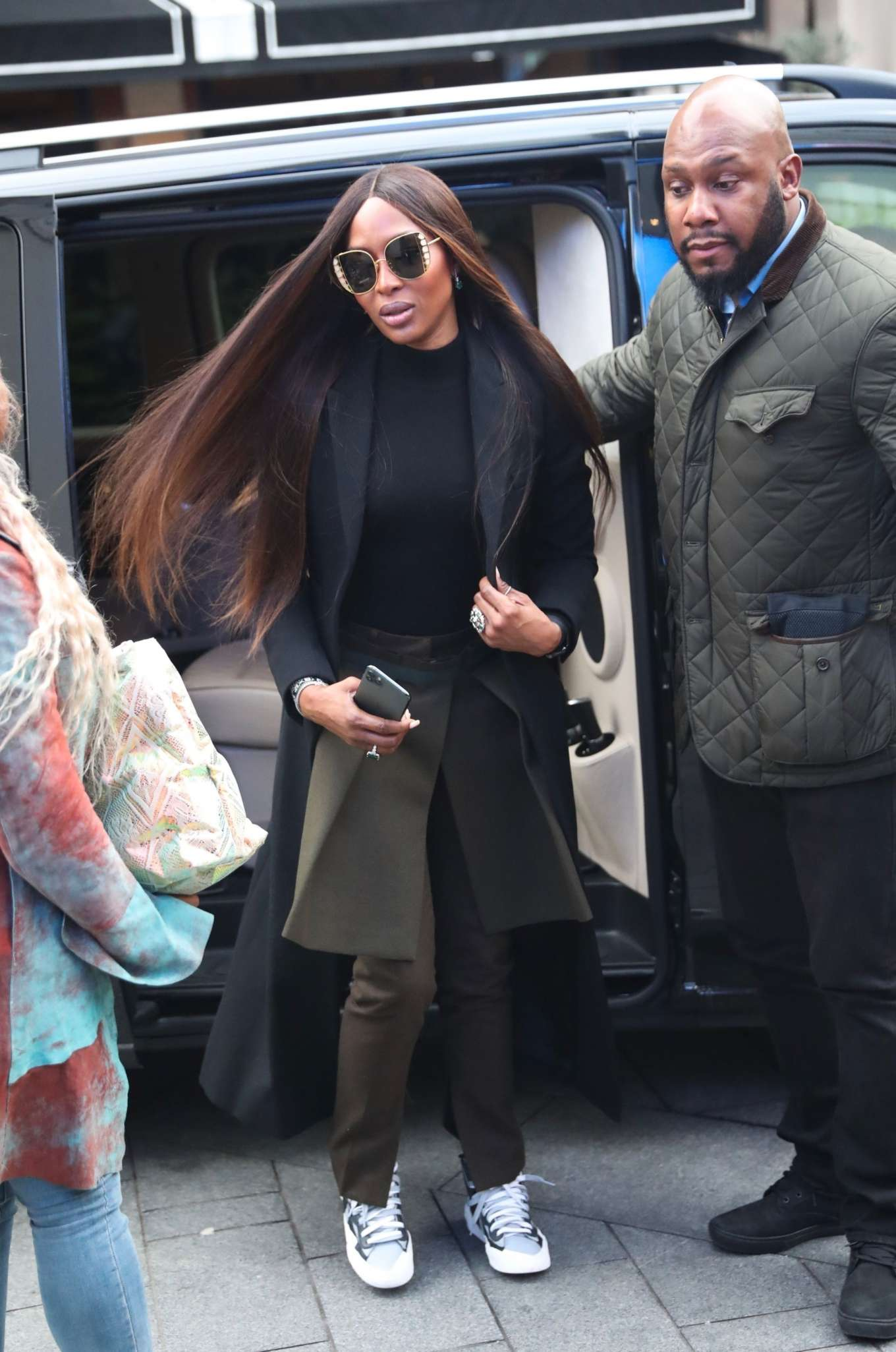 Naomi Campbell rocking pattern white black lace-up sneakers with chunky sole