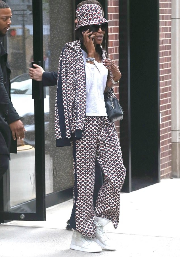 Naomi Campbell wearing a White and black striped jacket with full sleeves and striped