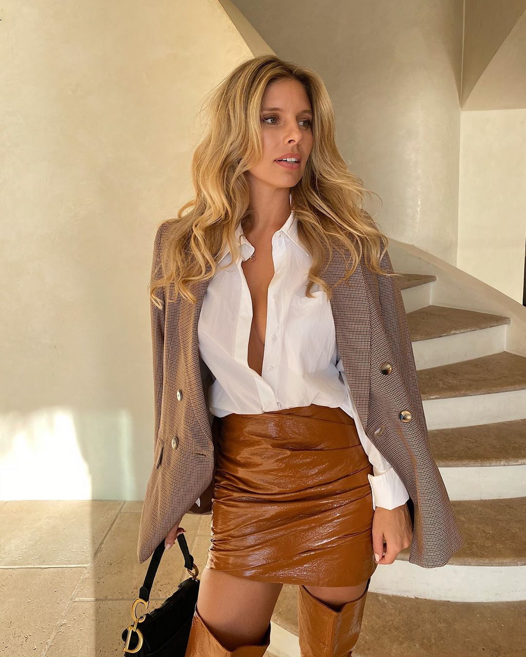 Natasha Oakley wearing narrow toffee leather thigh high boots