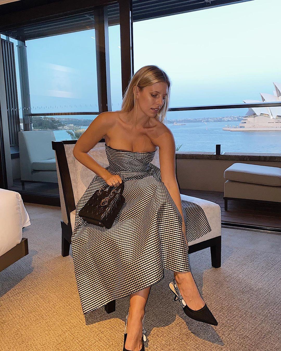 Natasha Oakley rocking a Plunging 22007 Christian Dior midi dress with cinched waist and flared hem