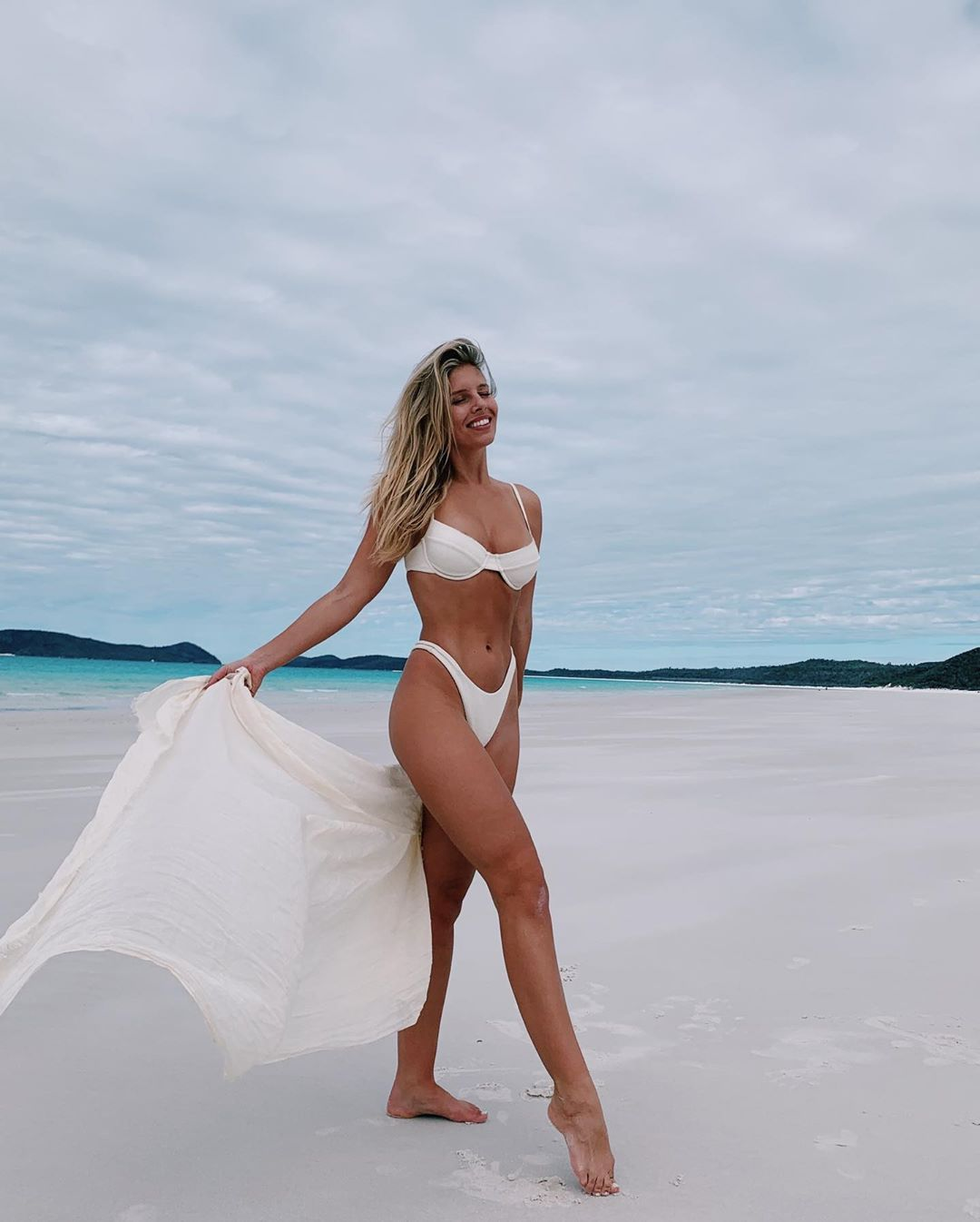 Natasha Oakley donning Ivory Monday Swimwear bikini bottom