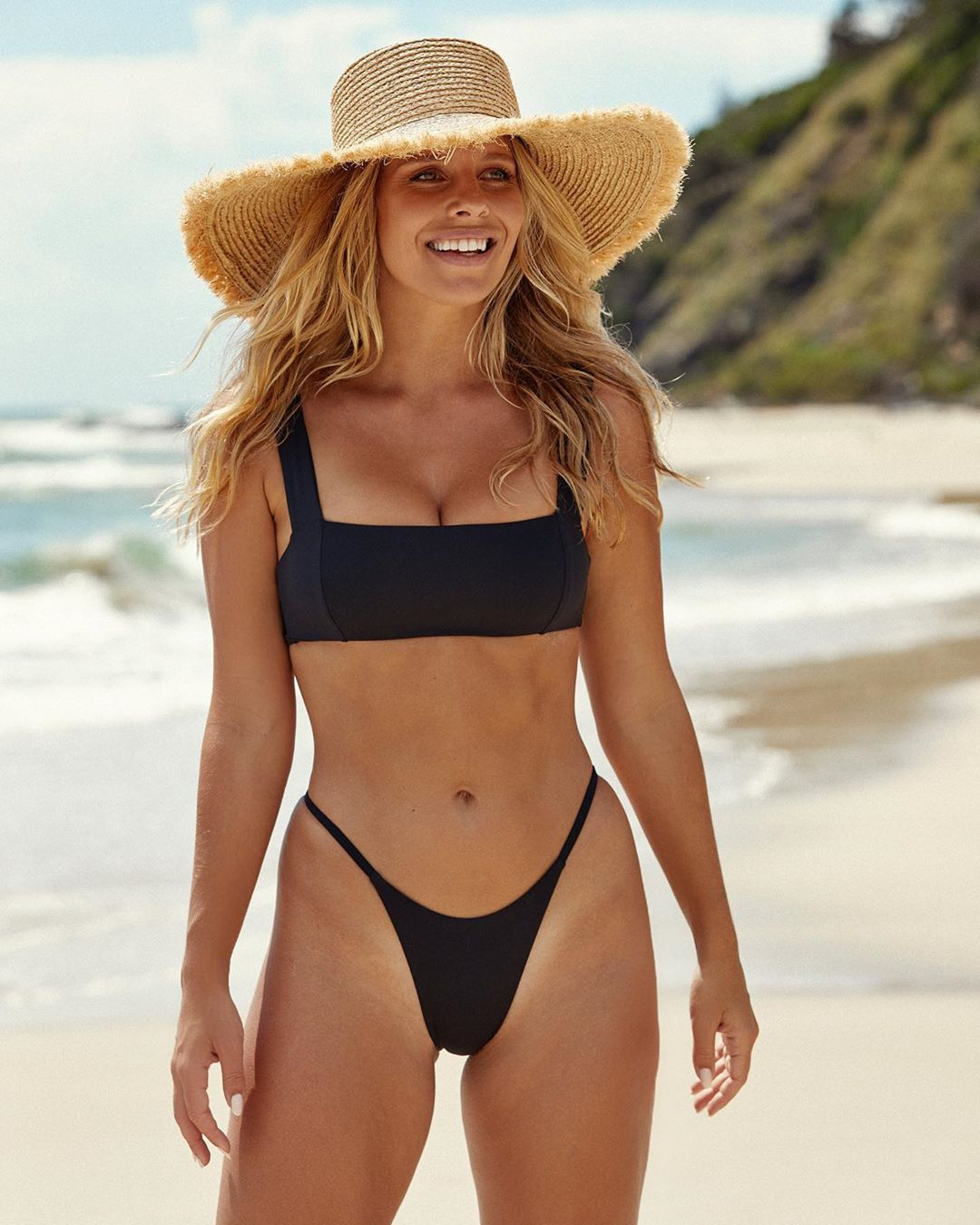 Natasha Oakley rocking Black cheeky Monday Swimwear bikini bottom