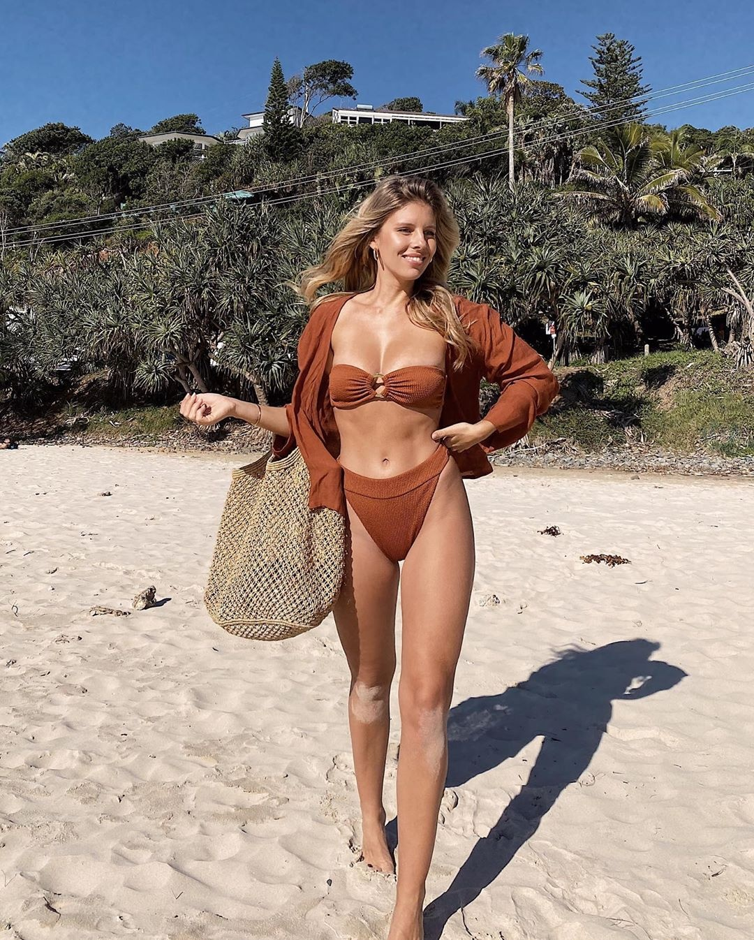 Natasha Oakley rocking a Clay open front Monday Swimwear linen shirt with a linen fabric and full sleeves