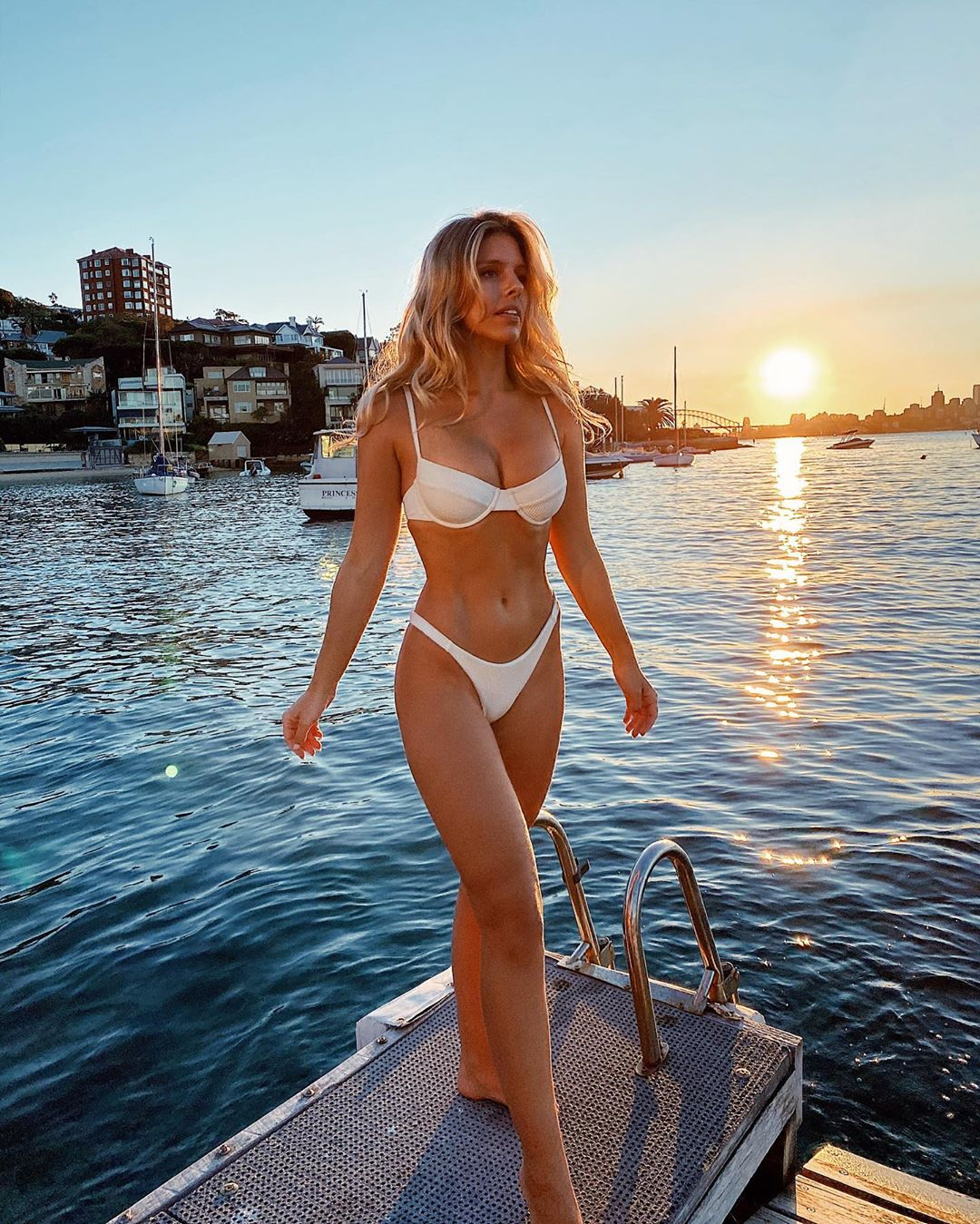 Natasha Oakley donning Skimpy ivory ribbed Monday Swimwear bikini bottom with a ribbed fabric material