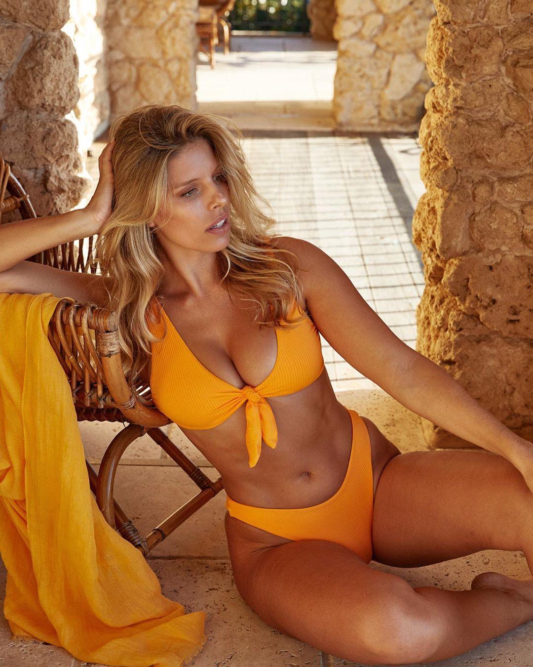 Natasha Oakley rocking Skimpy tangerine ribbed Monday Swimwear bikini bottom with a ribbed fabric material