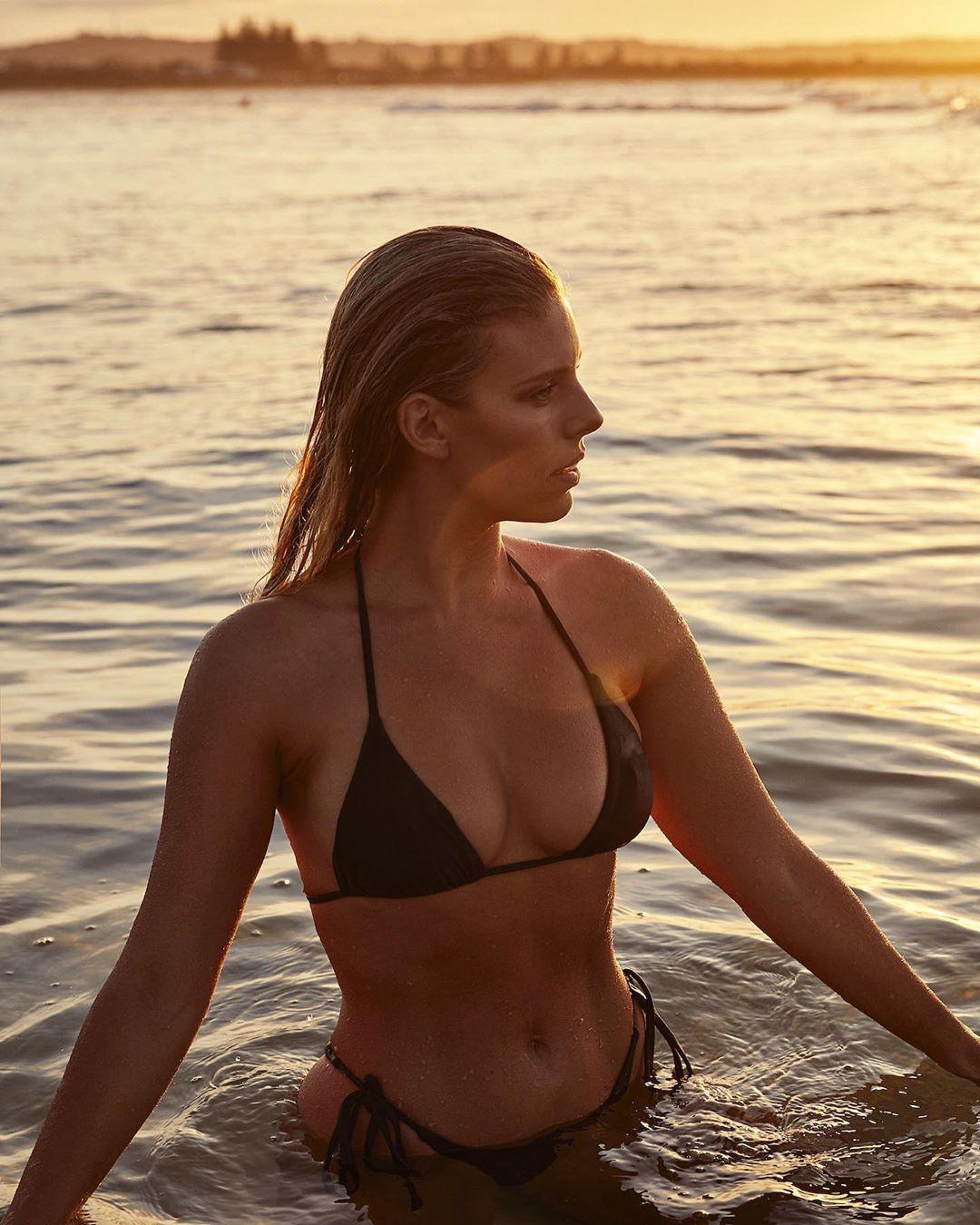 Natasha Oakley wearing a Plunging black Monday Swimwear bikini top with spaghetti straps