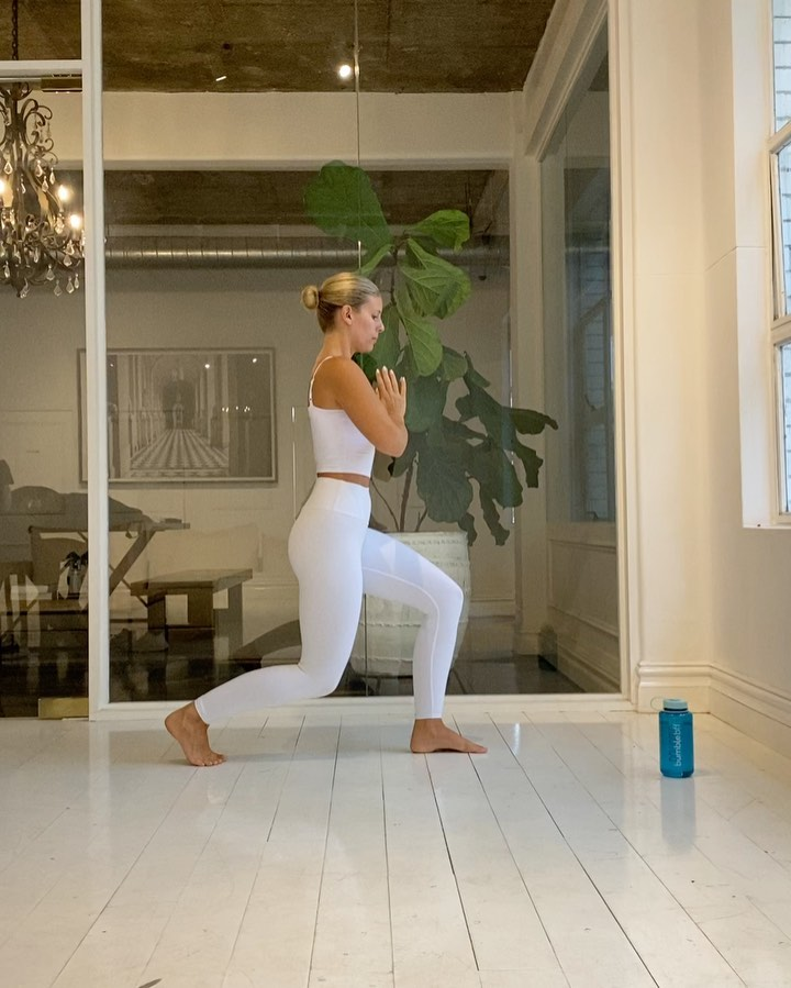 Natasha Oakley donning Skinny white high waist Alo Yoga workout leggings with a stretch fabric material