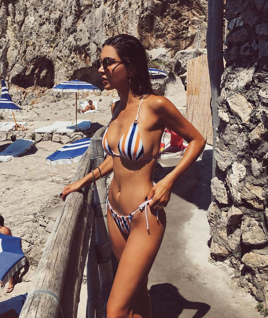 Negin Mirsalehi wearing a Plunging blue white mustard Lavish Alice bikini top with striped and spaghetti straps
