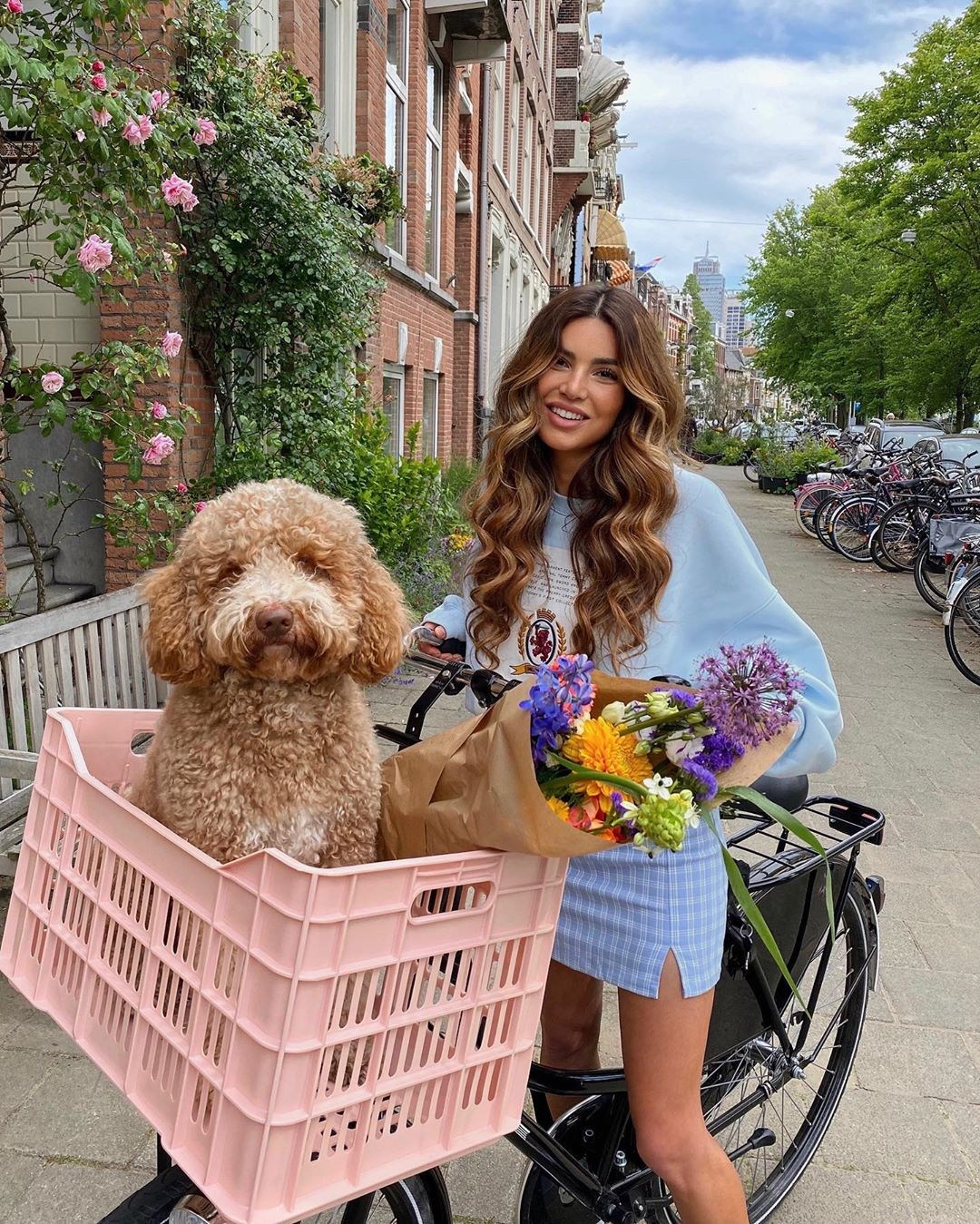 Negin Mirsalehi donning a Oversized sky blue sweatshirt with extra long sleeves, embroidered and a crew neck