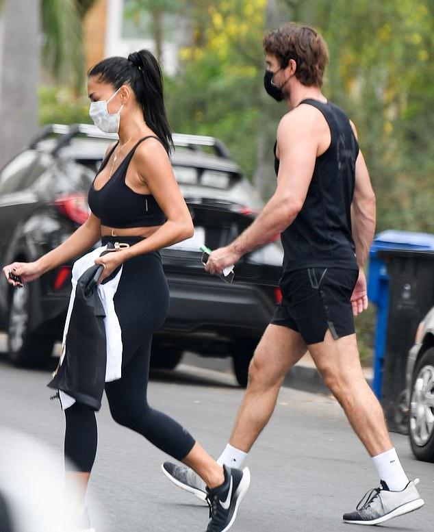 Nicole Scherzinger rocking black Nike lace-up sneakers